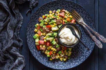 Salad with avocado tomato corn mushrooms and mayonnaise