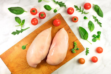 Chicken fillets with cherry tomatoes, greens and copyspace