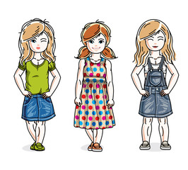Beautiful little girls cute children standing in stylish casual clothes. Vector set of beautiful kids illustrations.