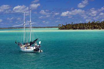 Sailing boat in Tabuaeran (Fanning Island) lagoon, Kribati.