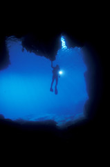 Diver at the enterance of a marine cave, Sarigerme Turkey