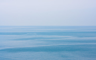 Blue clean sea or ocean and clear sky background