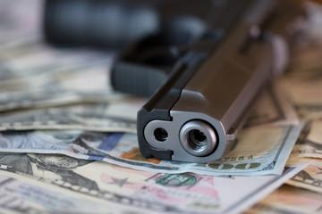 gun with money close up