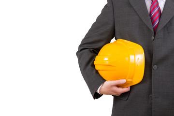 Architekt mit Anzug und gelbem Helm