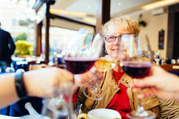 women celebrate over wine in Piano di Sorrento, Italy