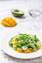 Avocado mango arugula pine nuts Mozzarella salad