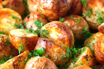 The toasted baked potato strewed with herbs