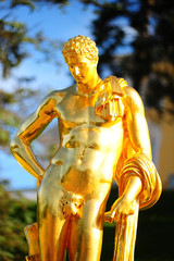 Gold plated sculptures by fountains Grand cascade in Pertergof, Saint-Petersburg, Russia