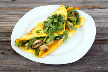 Stuffed vegetable omelet on wooden background