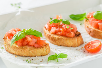 Tasty bruschetta with basil and tomato for a snack