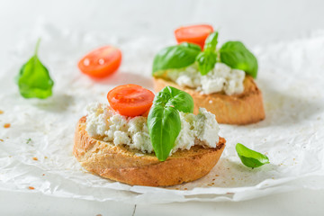 Tasty bruschetta with ricotta cheese and tomato for a snack
