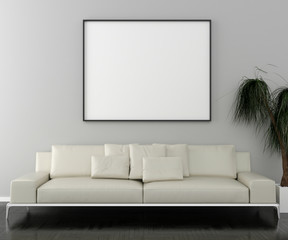 Blank picture frame and sofa with interior plant.