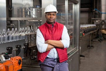 male employee standing by production line