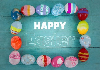 White type surrounded by easter eggs on teal table