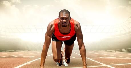 Male runner on track against flares