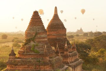 Epic sunrise scene among temples with hot air balloons in Bagan Myanmar