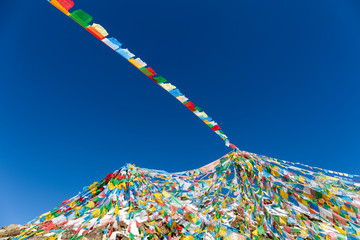 the wind-horse flags on tibet against a blue sky