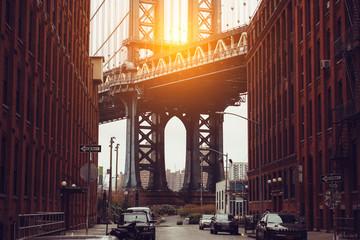 Sunset in New York City. Dumbo area with Manhattan Bridge scenic view.