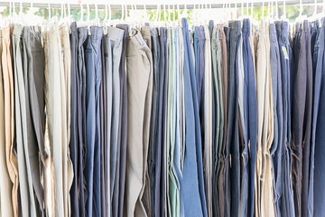 Row of old various woolen trousers