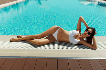 Sexy Woman With Hot Body In  Bikini Sunbathing At Pool In Summer