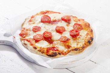 Pizza Margherita on white wooden background