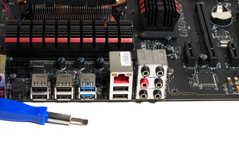 Kind of motherboard on the side with tools and parts for repair