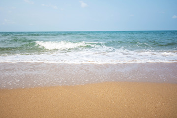 Soft wave of blue ocean on sandy beach at sunny day.
