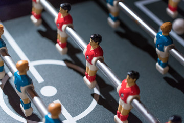 Table football kicker with miniature players