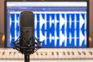 condenser microphone on music computer background. music technology concept