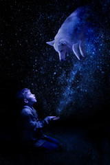 Fairytale photography. Magic and witchcraft. The boy conjures a wolf with a star