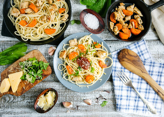 Composition of pasta, cheese, dishes. Serving Italian cuisine. Flat lay, top view