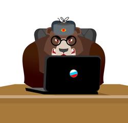 Russian hacker. Bear and laptop. IP technology in Russia. Wild beast in fur hat