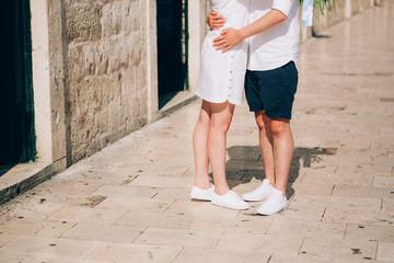 Legs is newlywed on the stone floor. Wedding in Montenegro.