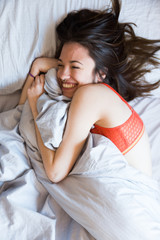 Laughing girl in bed