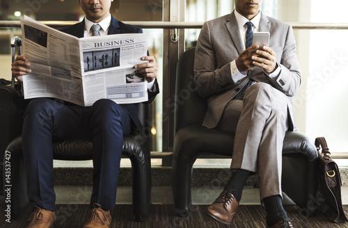 business men break sit read newspaper stockfotos und lizenzfreie bilder auf bild. Black Bedroom Furniture Sets. Home Design Ideas