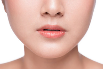 Young asian woman close up. Perfect natural lip makeup