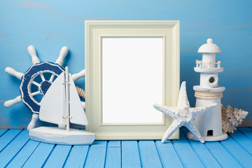 Summer holiday vacation concept with photo frame and nautical decorations