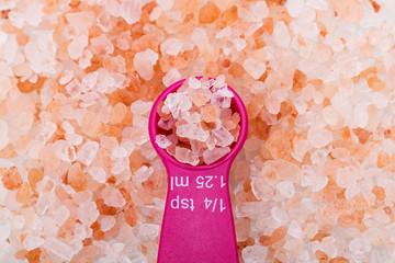 Closeup of Himalayan pink rock salt on a Magenta 1.25 ml spoon