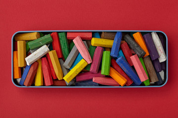 Colorful crayons on red