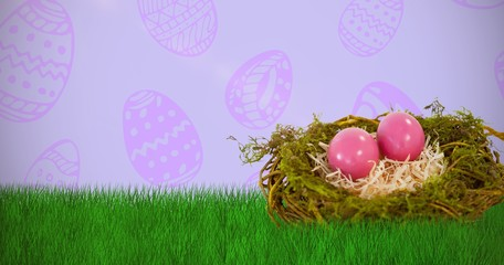 Composite image of pink easter eggs on artificial nest