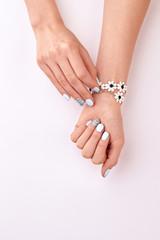 Wall Mural - Beautiful manicure. Cute floral bracelet.