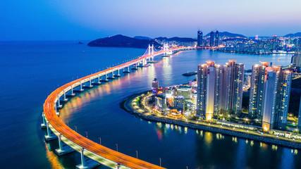 Busan Gwangandaegyo Bridge or GwangAn Bridge and Haeundae aerial view at night, Busan, South Korea.