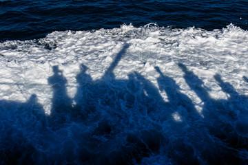 Shadow of people on sea
