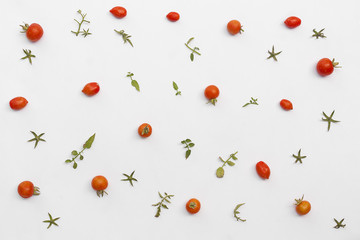 tomatoes and leaves pattern on white background. Flat lay.