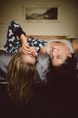 Happy friends enjoying on bed