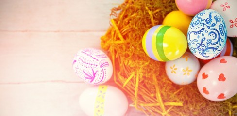 Painted Easter eggs against blue wood background