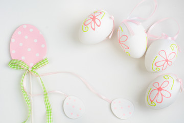 Easter pastel eggs decor on white background. Space for your text. Top view.