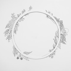 Floral round frame with drawing leaves