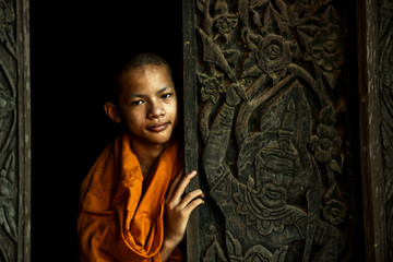 Novice monk at an old temple in thailand