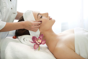 Find Similar  Get a Comp  Save to LightboxSpa salon: young beautiful woman having facial treatment.